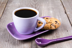 purple-coffee-cup-saucer-spoon-gray-wooden-table-80853020